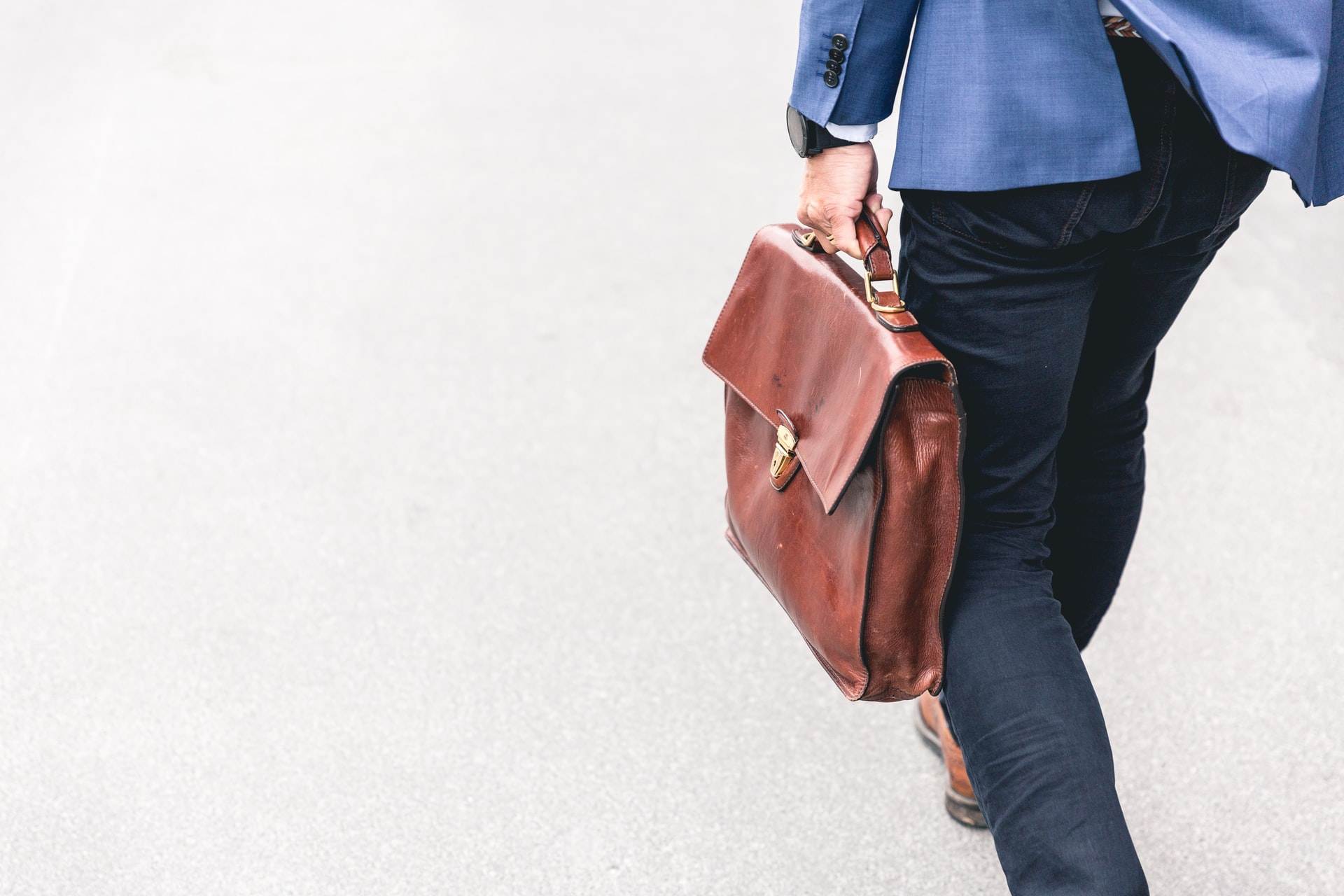 man-walking-with-briefcase